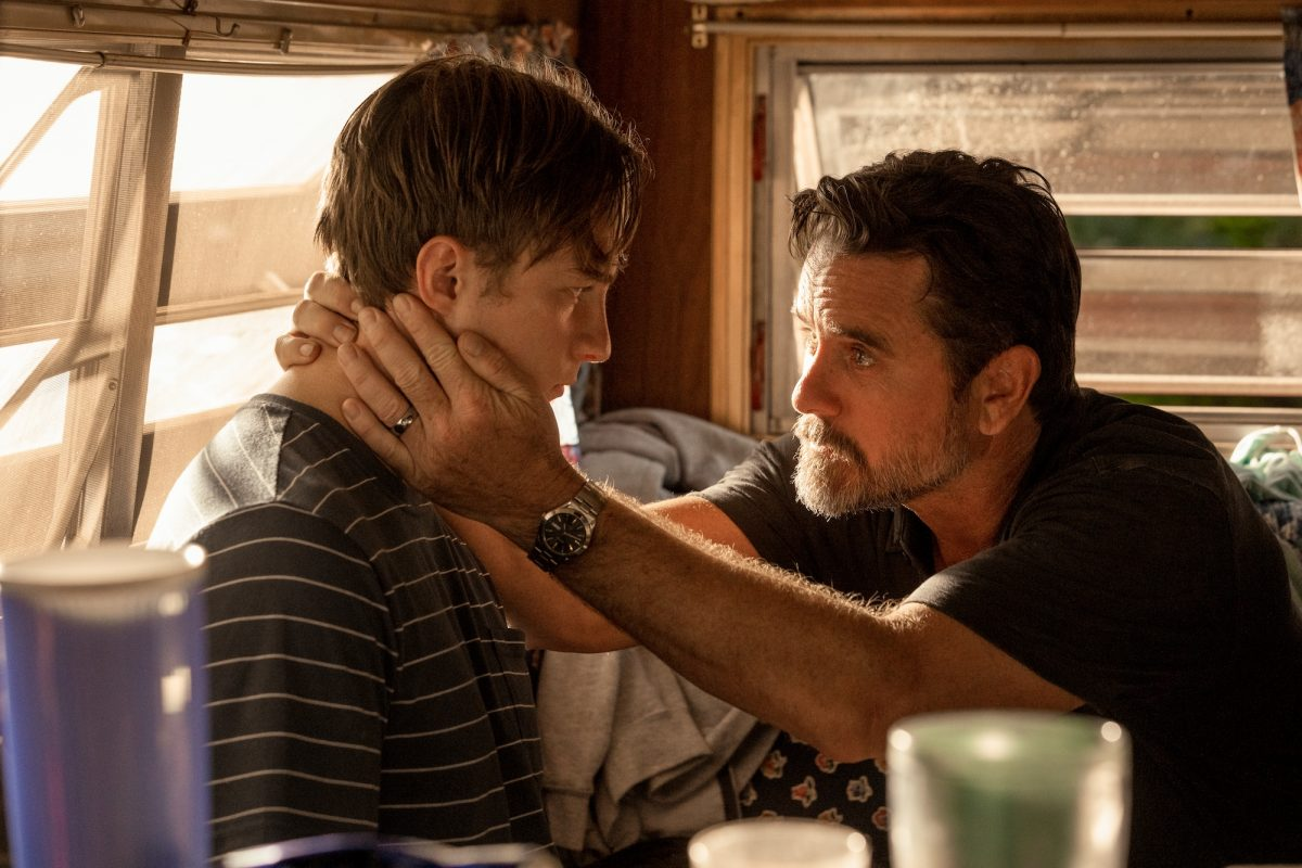 DREW STARKEY as RAFE and CHARLES ESTEN as WARD CAMERON in 'Outer Banks' Season 2