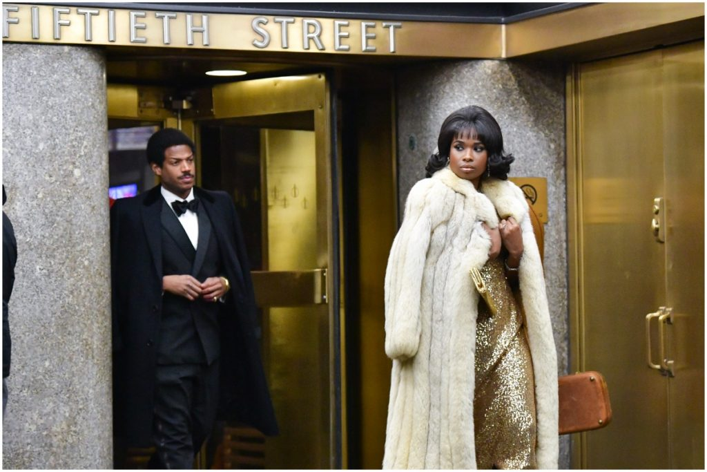 'Respect' stars Jennifer Hudson and Marlon Wayans as Aretha Franklin and Ted White walking out of a building at night.