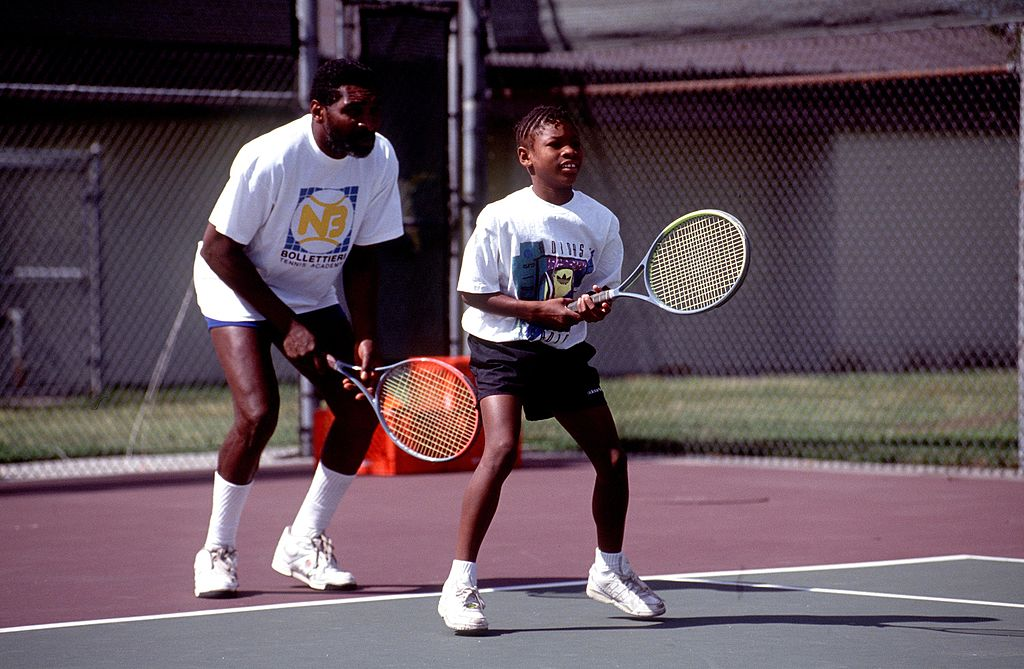 Richard Williams practices with his young daughter, Serena play tennis on the tennis court in 1991.