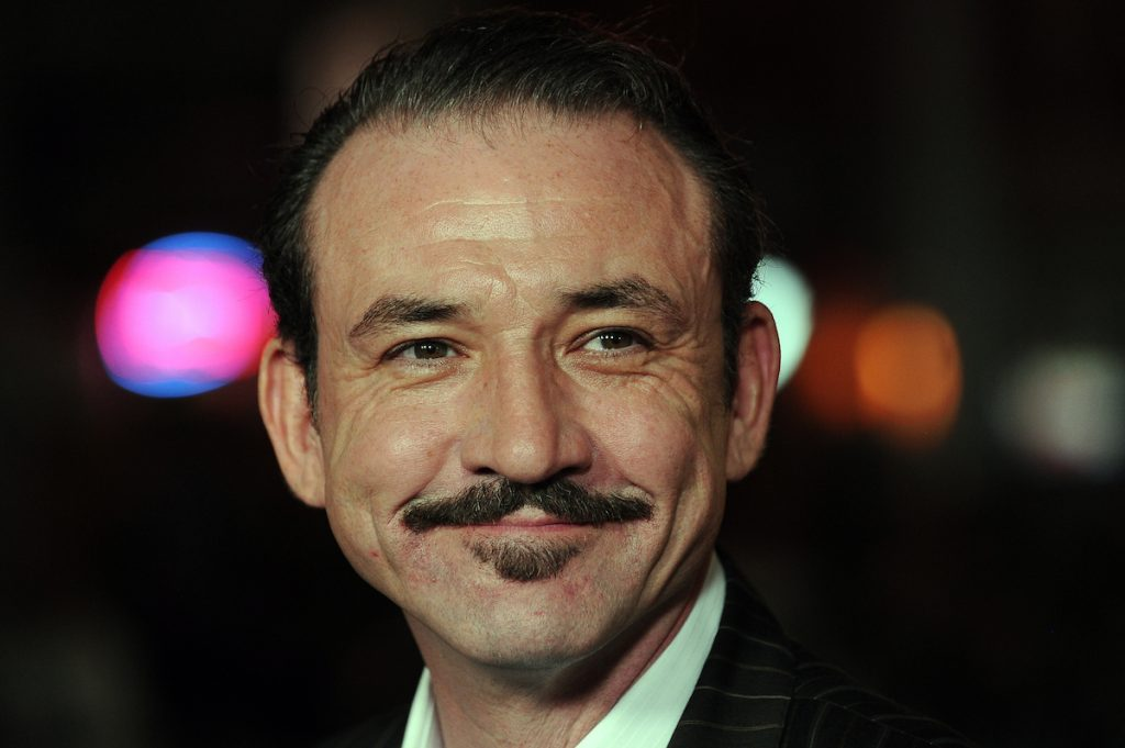 """Actor Ritchie Coster arrives at the premiere of HBO's """"Luck,"""" at Grauman's Chinese Theatre in Hollywood, California January 25, 2012 ."""