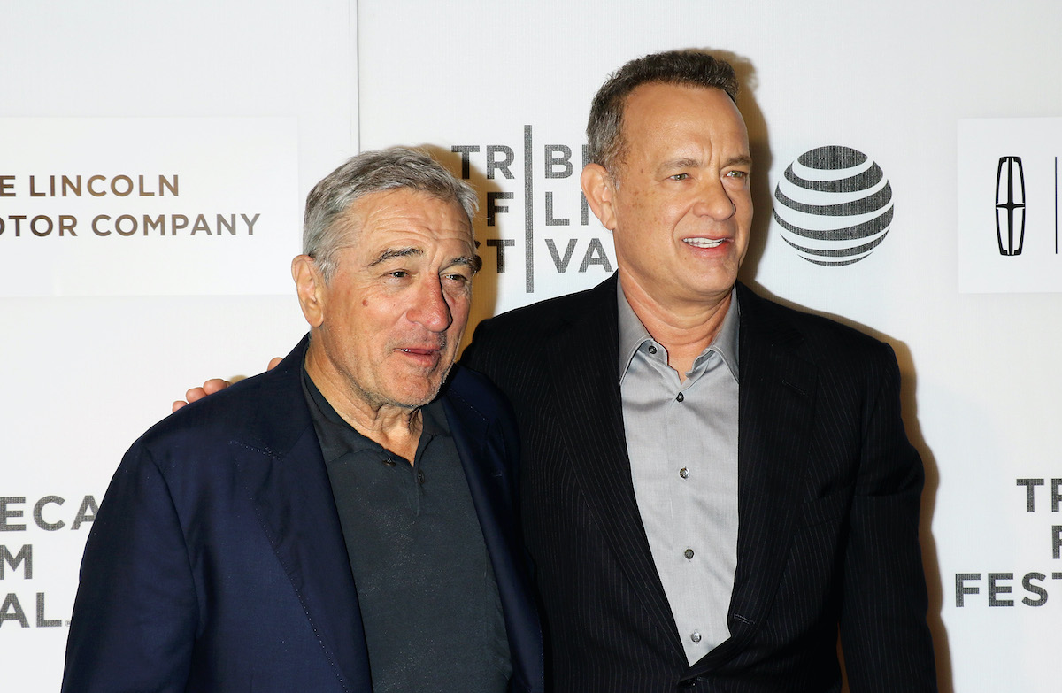 Robert De Niro and Tom Hanks smile and pose on the red carpet