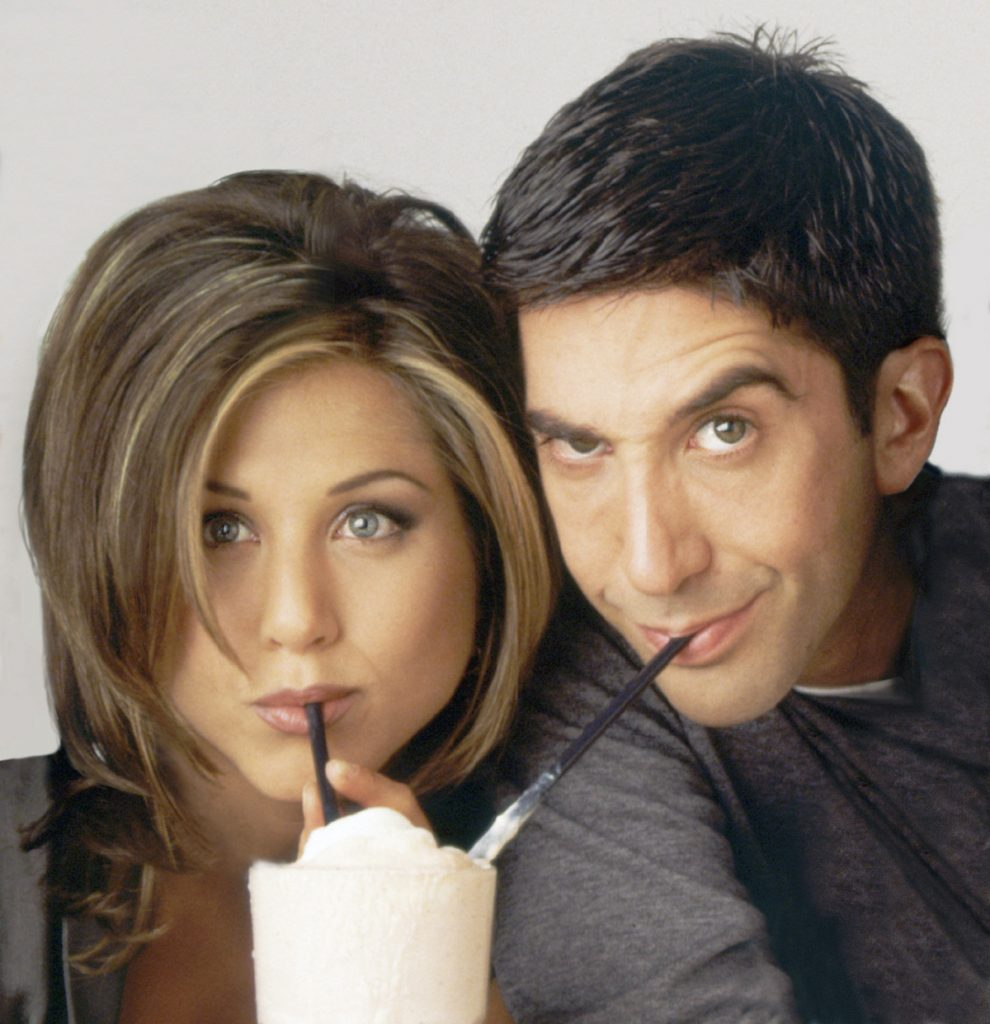 David Schwimmer as Ross and Jennifer Aniston as Rachel share one milkshake with two straws.