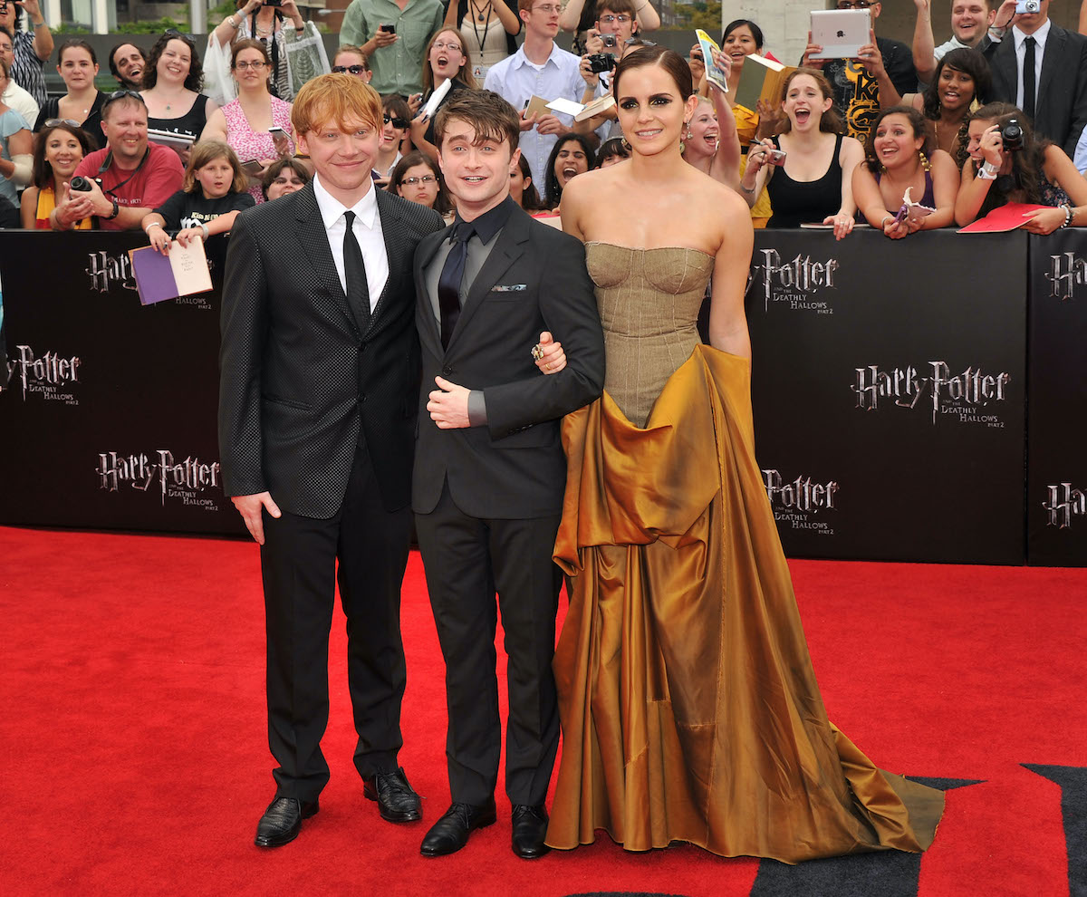 Harry Potter and the Deathly Hallows – Part 2 star Rupert Grint, Daniel Radcliffe, and Emma Watson