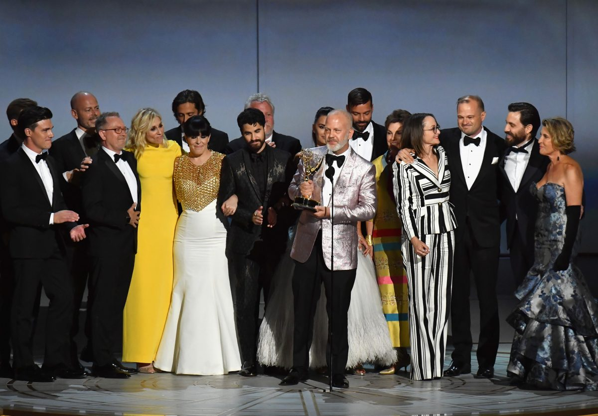 Ryan Murphy and cast and crew talking onstage to receive the Outstanding Limited Series award for The Assassination of Gianni Versace: American Crime Story