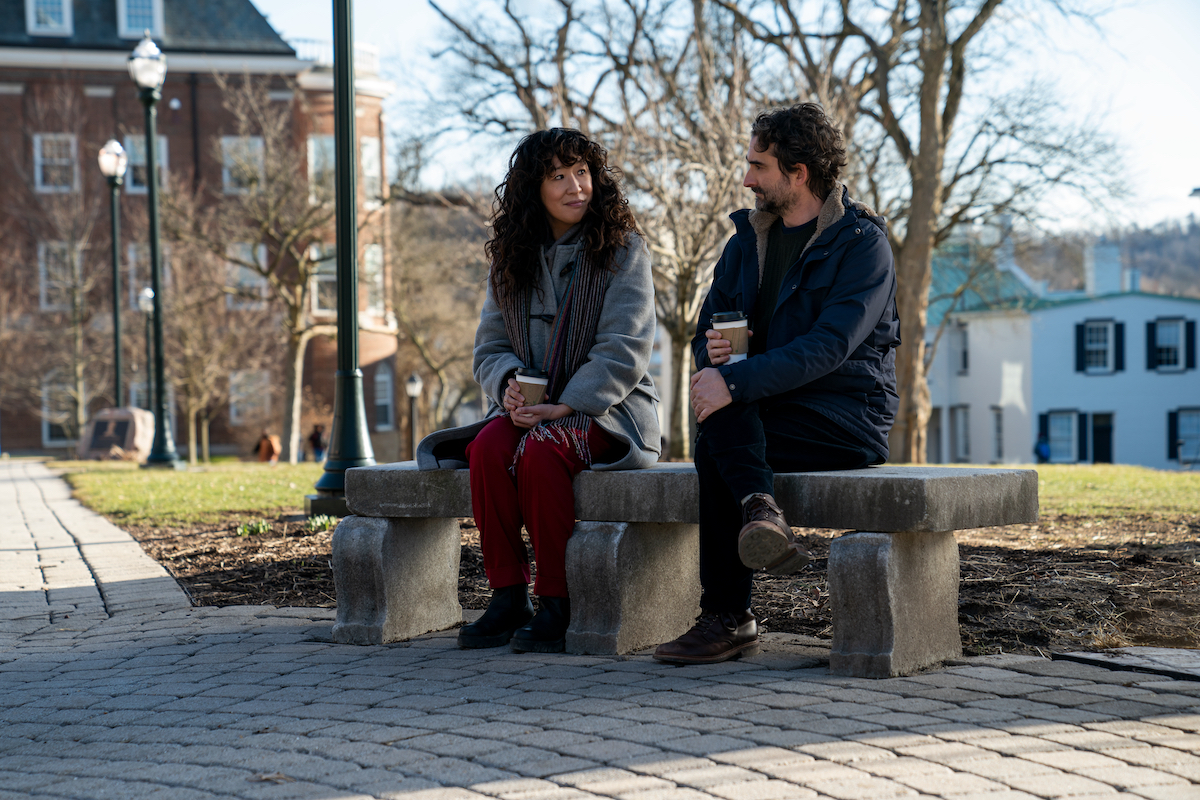 Sandra Oh and Jay Duplass sit at a bench holding cups of coffee in 'The Chair' Season 1 Episode 6