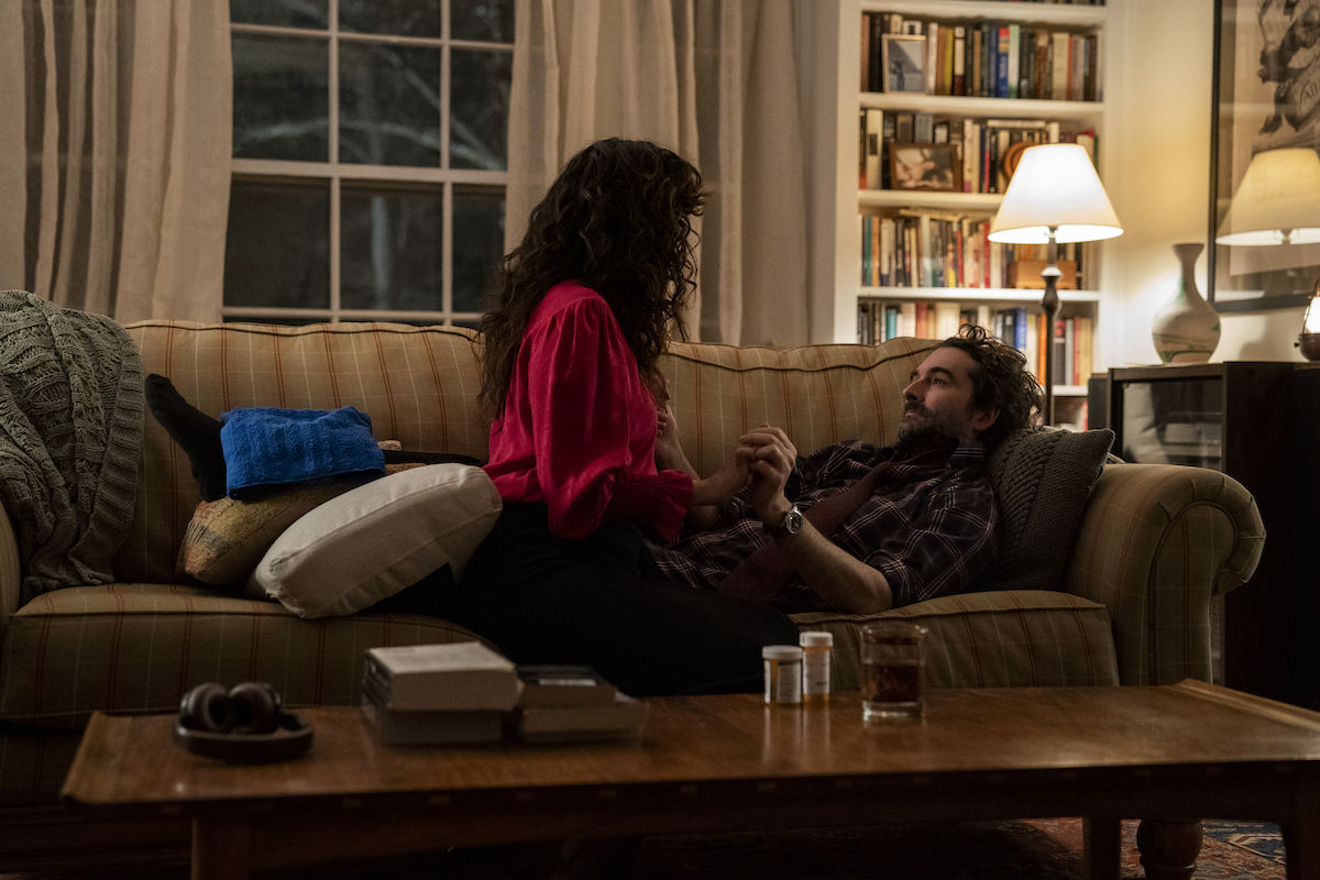 Sandra Oh holds hands with Jay Duplass while sitting on a couch during 'The Chair' Season 1