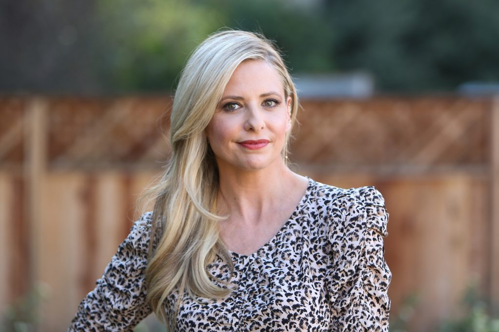 Sarah Michelle Gellar smiling in front of a blurred background
