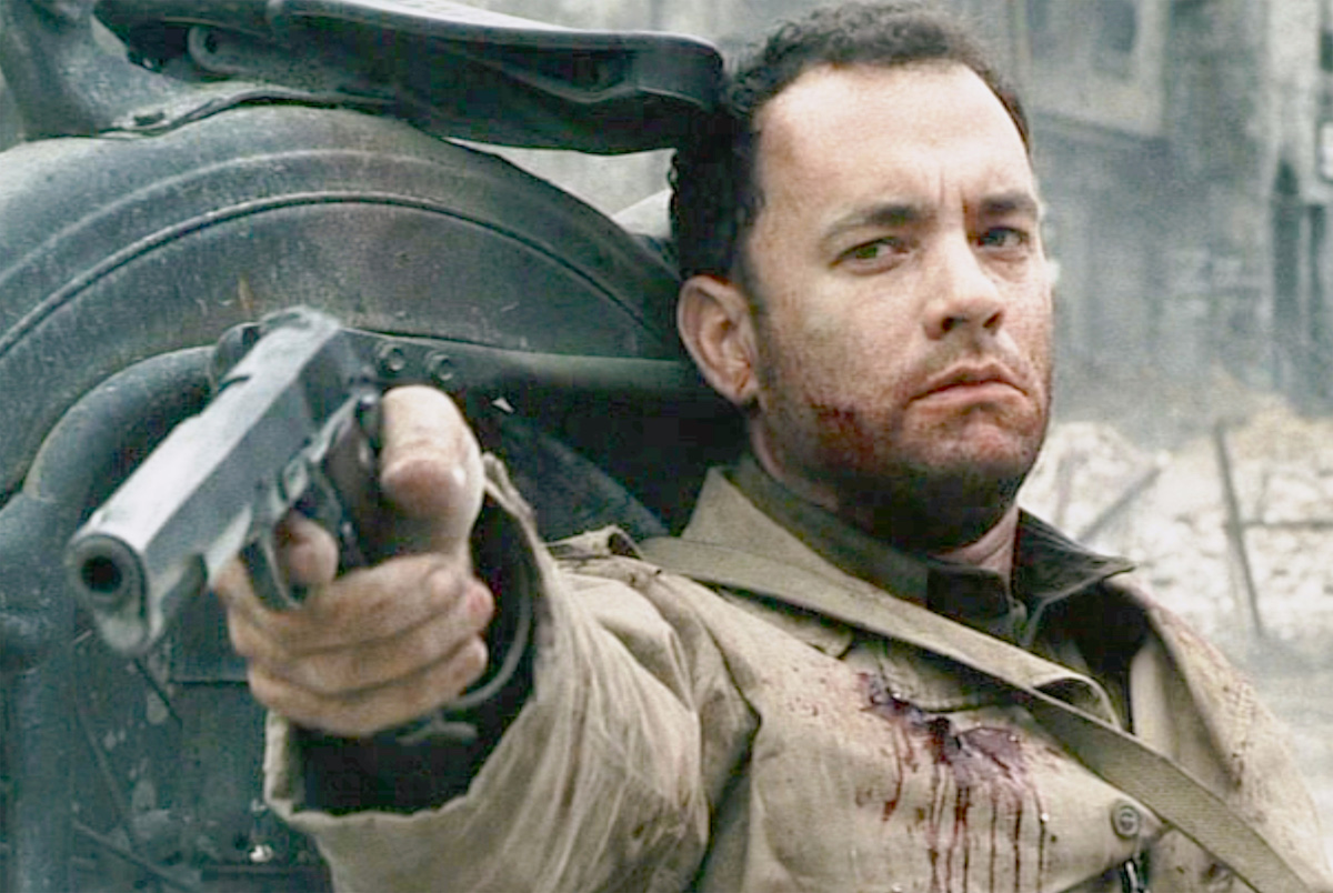 Tom Hanks weakly aims a pistol in a scene from 'Saving Private Ryan'