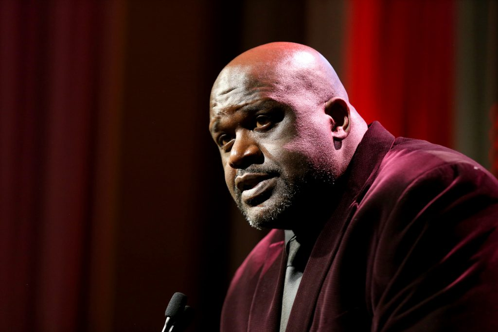 Shaquille O'Neal speaking into a mic