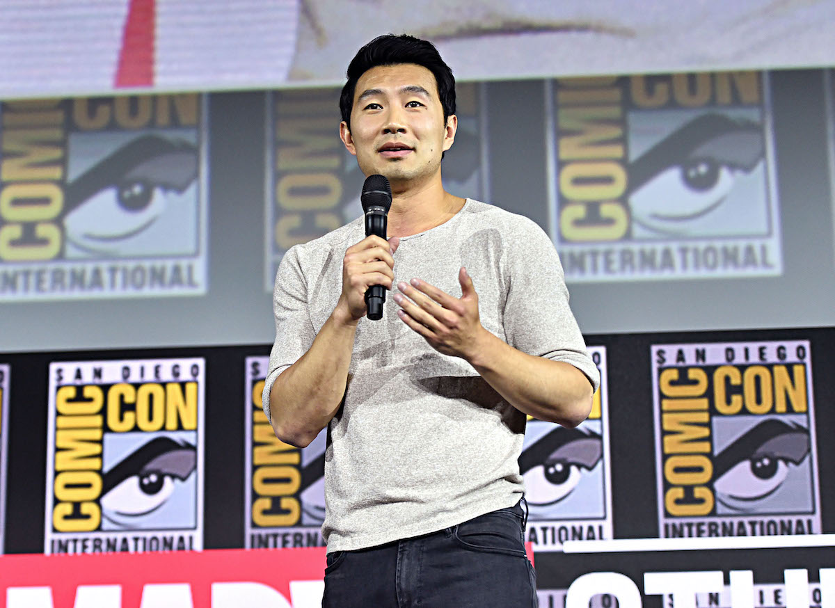 'Shang-Chi and the Legend of the Ten Rings' star Simu Liu stands onstage