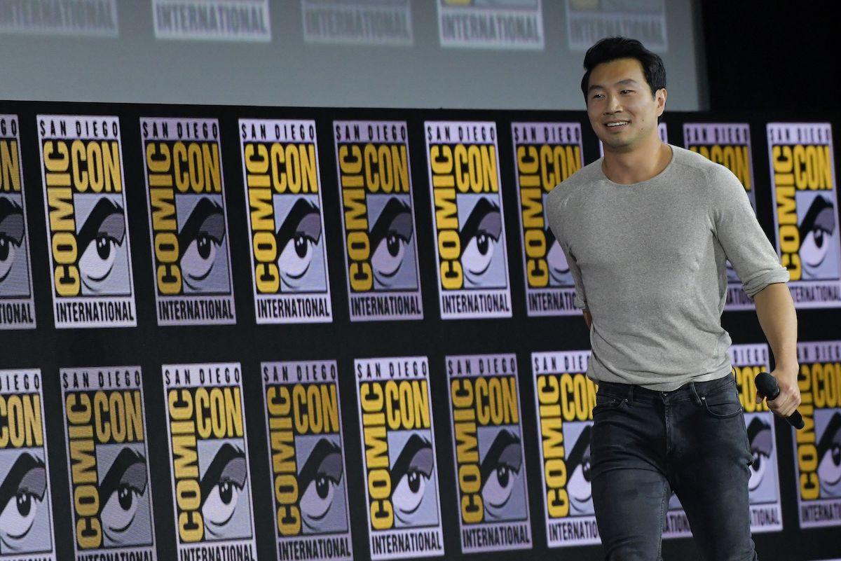 Simu Liu wearing gray shirt