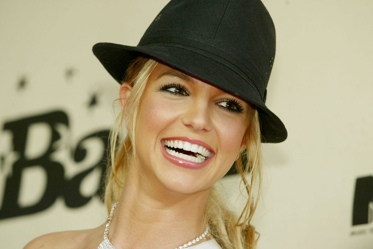 Britney Spears wearing hat and smiling at Hollywood palladium