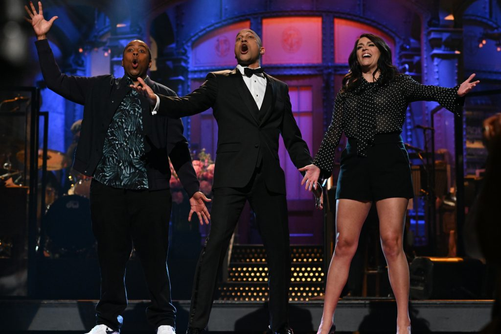 Cast members of 'Saturday Night Live' singing on the 'SNL' stage