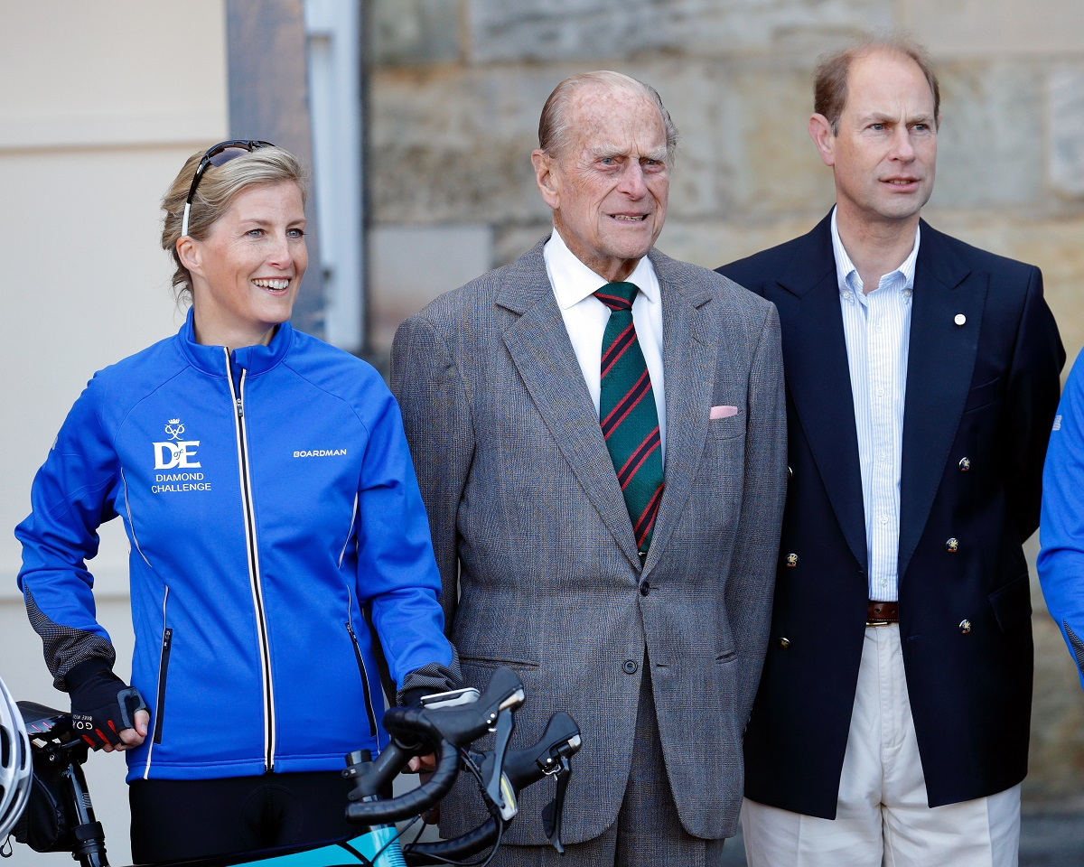Sophie, Countess of Wessex posing for a photograph alongside Prince Philip and Prince Edward