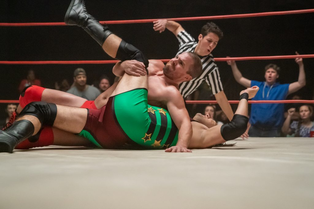 Stephen Amell pins his opponent in Heels