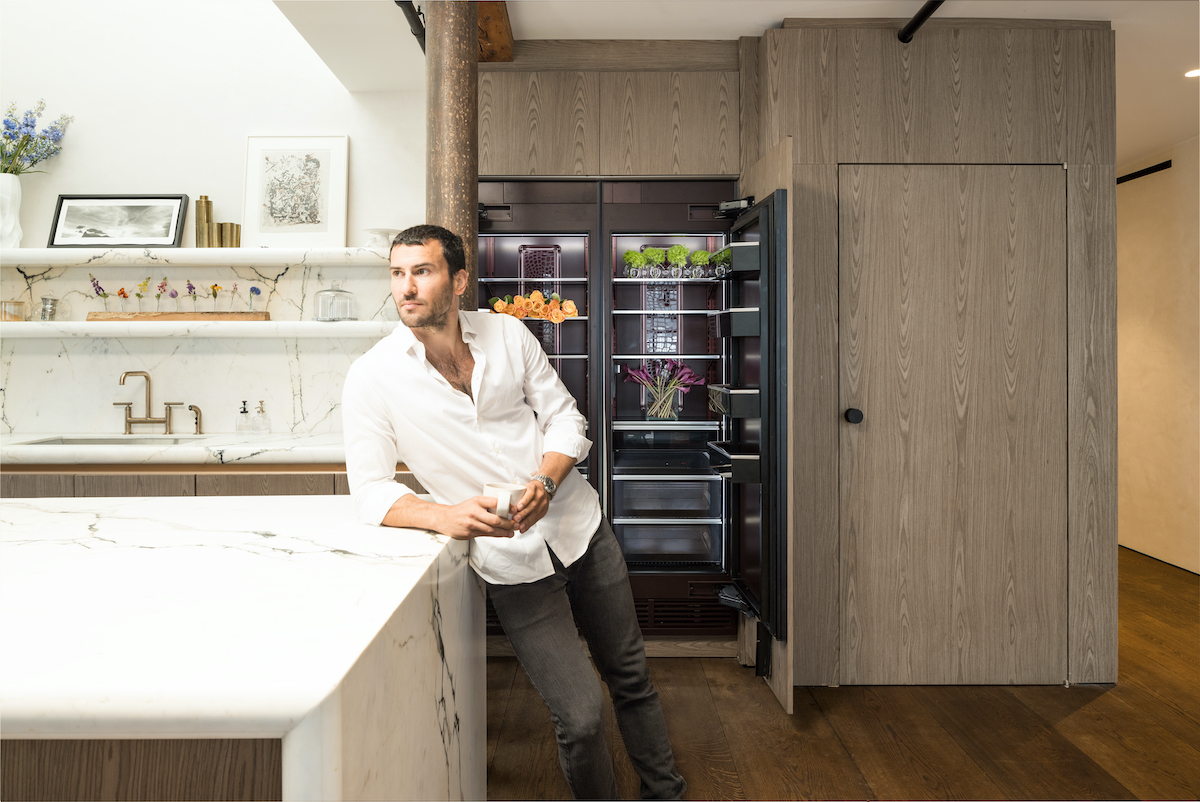 Steve Gold from 'Million Dollar Listing New York' leaning against a kitchen island