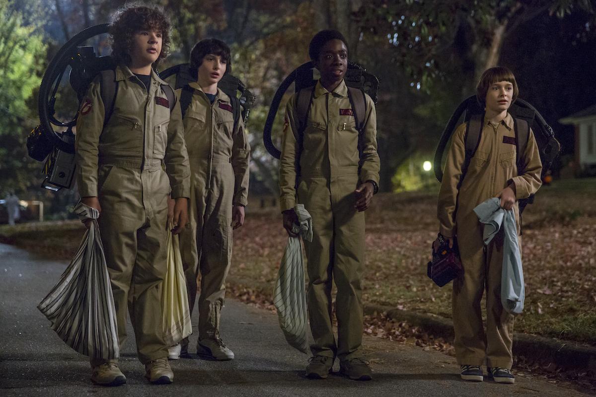(L-R) Gaten Matarazzo, Finn Wolfhard, Caleb McLaughlin, and Noah Schnapp dressed like the Ghostbusters in 'Stranger Things' Season 2.