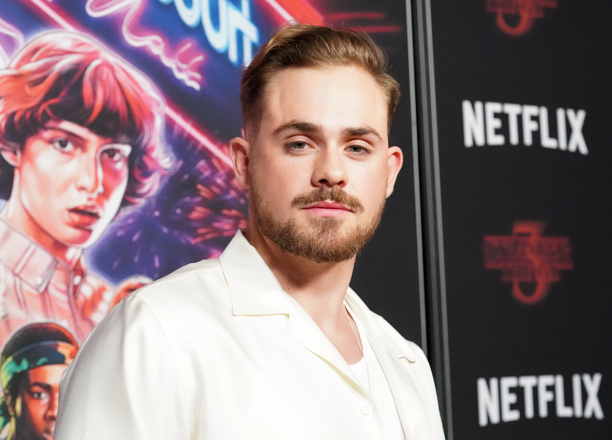 'Stranger Things' Dacre Montomgery in a white tshirt and jacket at the premiere of season 3.