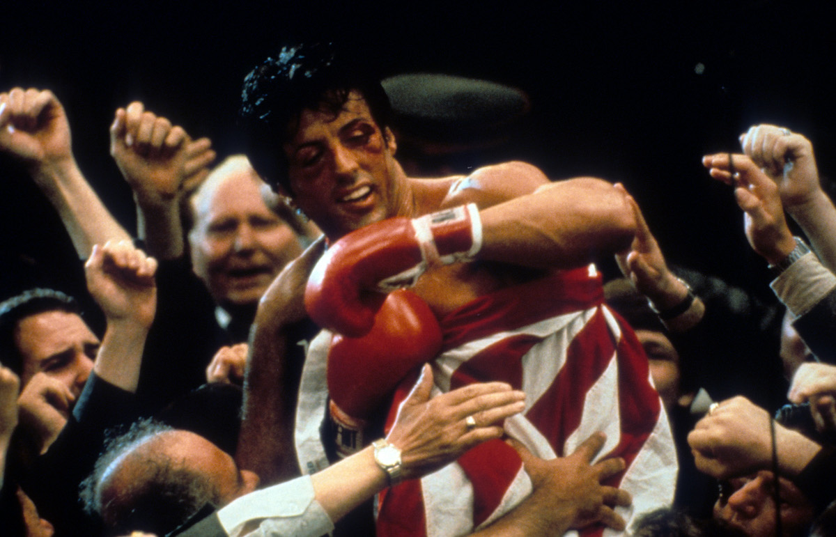 A bruised and battered Rocky (Sylvester Stallone) in the boxing ring