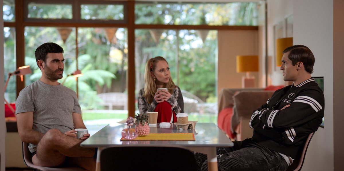 Roy Kent, Keeley Jones, and Jamie Tartt sit at a table together in 'Ted Lasso'