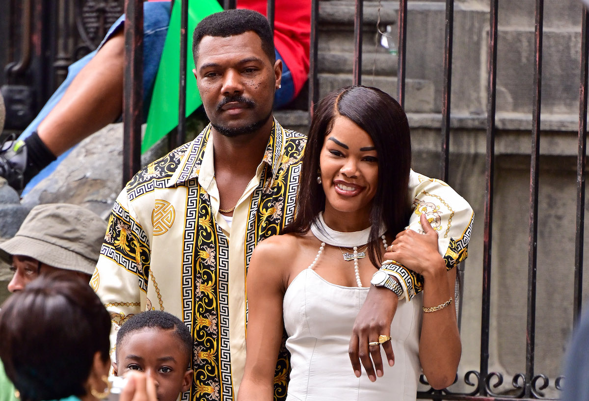 """Teyana Taylor (R) in a cream dress, seen on the set of """"A Thousand and One"""" in Harlem on August 09, 2021 in New York City."""