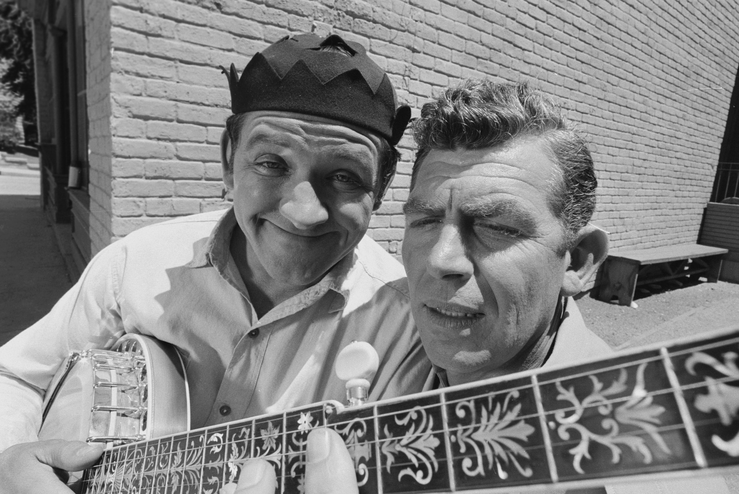 (Left to right): Actors George Lindsey as Goober Pyle and Andy Griffith as Sheriff Andy Taylor play the guitar on 'The Andy Griffith Show'