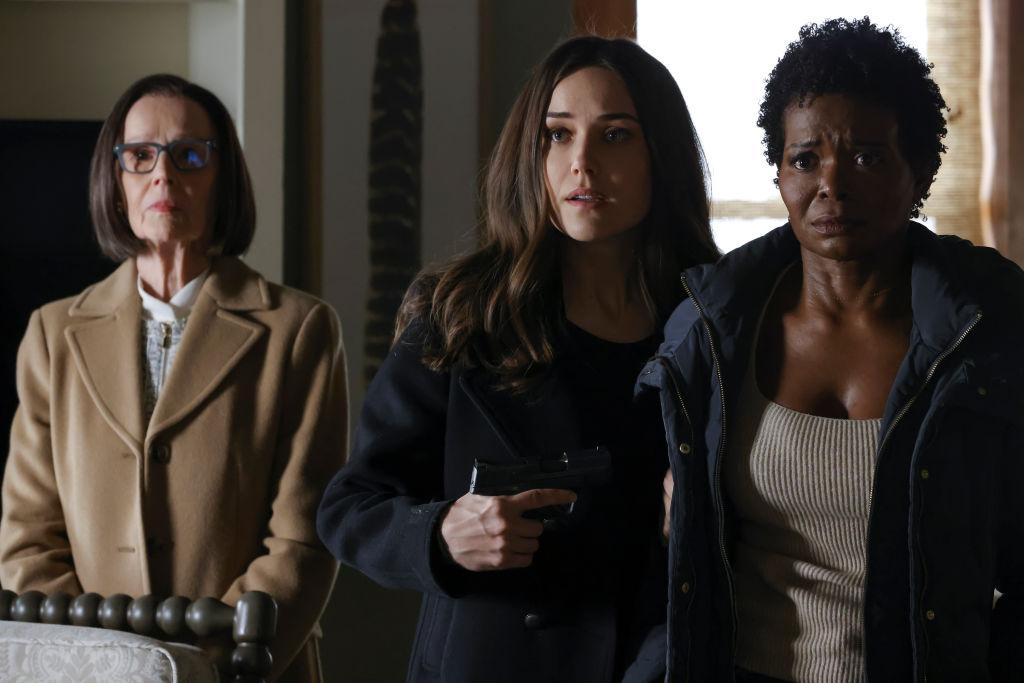 Susan Blommaert as Mr. Kaplan and Megan Boone as Liz Keen. Liz holds a gun to LaChanze as a terrified Anne.