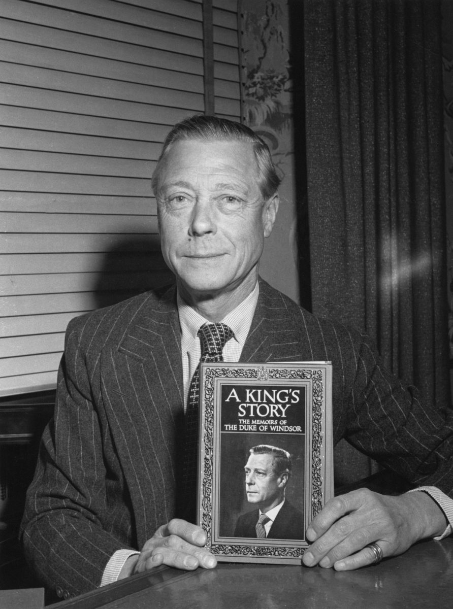 The Duke of Windsor formerly King Edward VIII holding his memoirs 'A King's Story The Memoirs of the Duke of Windsor'