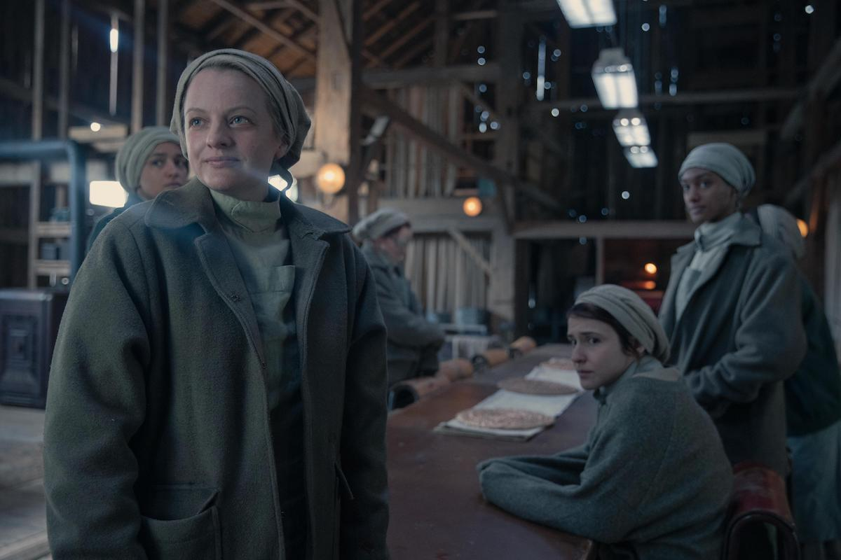 Elisabeth Moss and 'The Handmaid's Tale' Season 4 Episode 2 cast. Moss and the other women wear pale green Martha uniforms and gather in a large barn at a table. 'The Handmaid's Tale' Season 4 Episode 2, 'Nightshade,' marked a huge change in series.