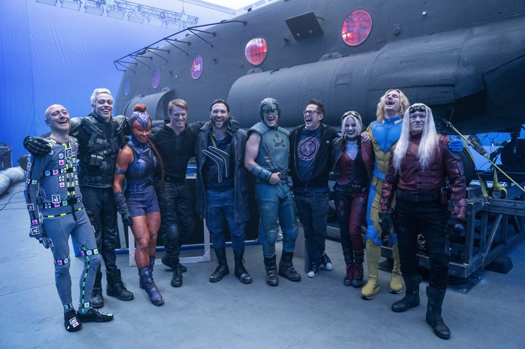 The Suicide Squad cast stands arm in arm with James Gunn