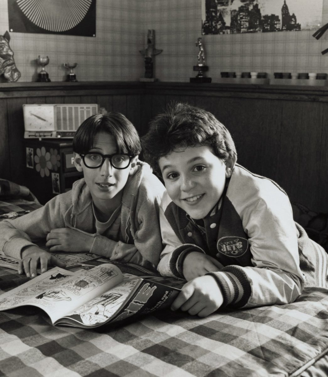 Paul Pfieffer and Kevin Arnold read a magazine together in a bedroom during an episode of 'The Wonder Years'