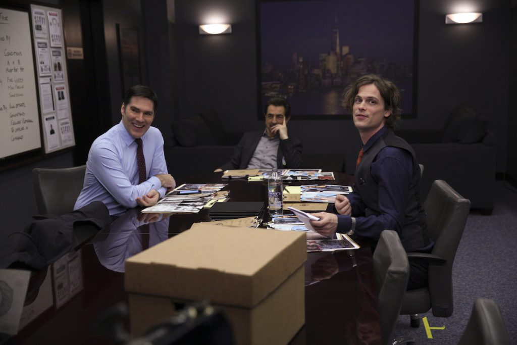 Thomas Gibson as Aaron Hotchner, Joe Mantegna as David Rossi, and Matthew Gray Gubler as Dr. Spencer Reid sitting together in 'Criminal Minds'