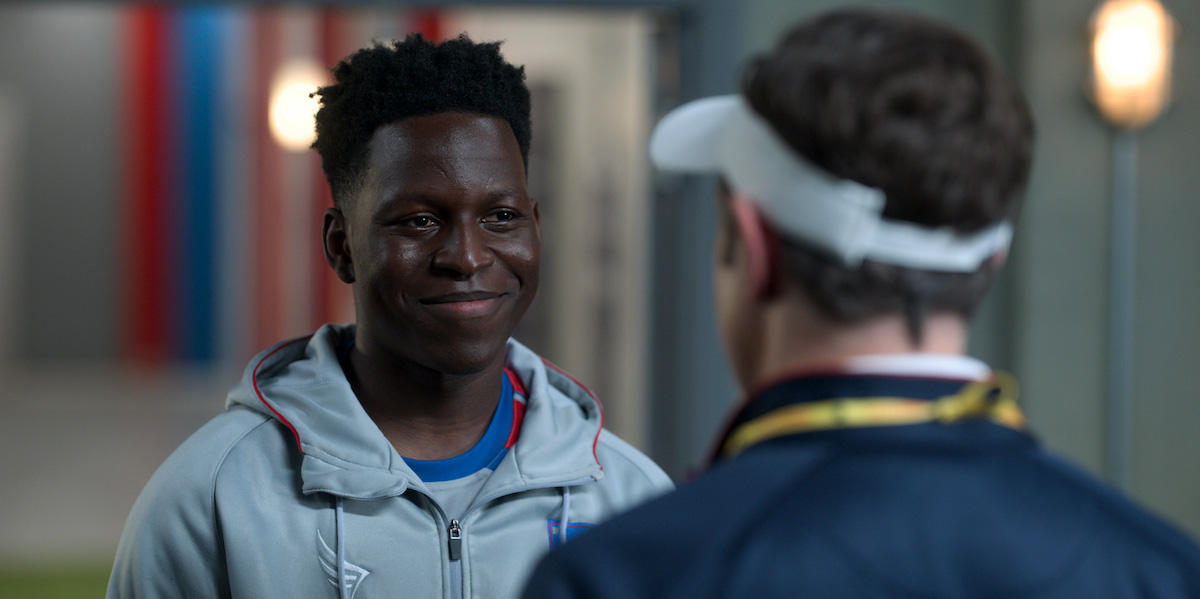 Toheeb Jimoh smiles as he speaks to Jason Sudeikis in 'Ted Lasso' Season 2