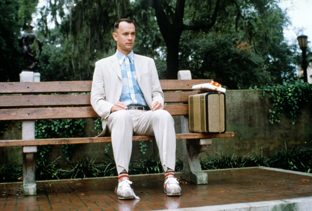 Tom Hanks sitting on a bench while filming of 'Forrest Gump'