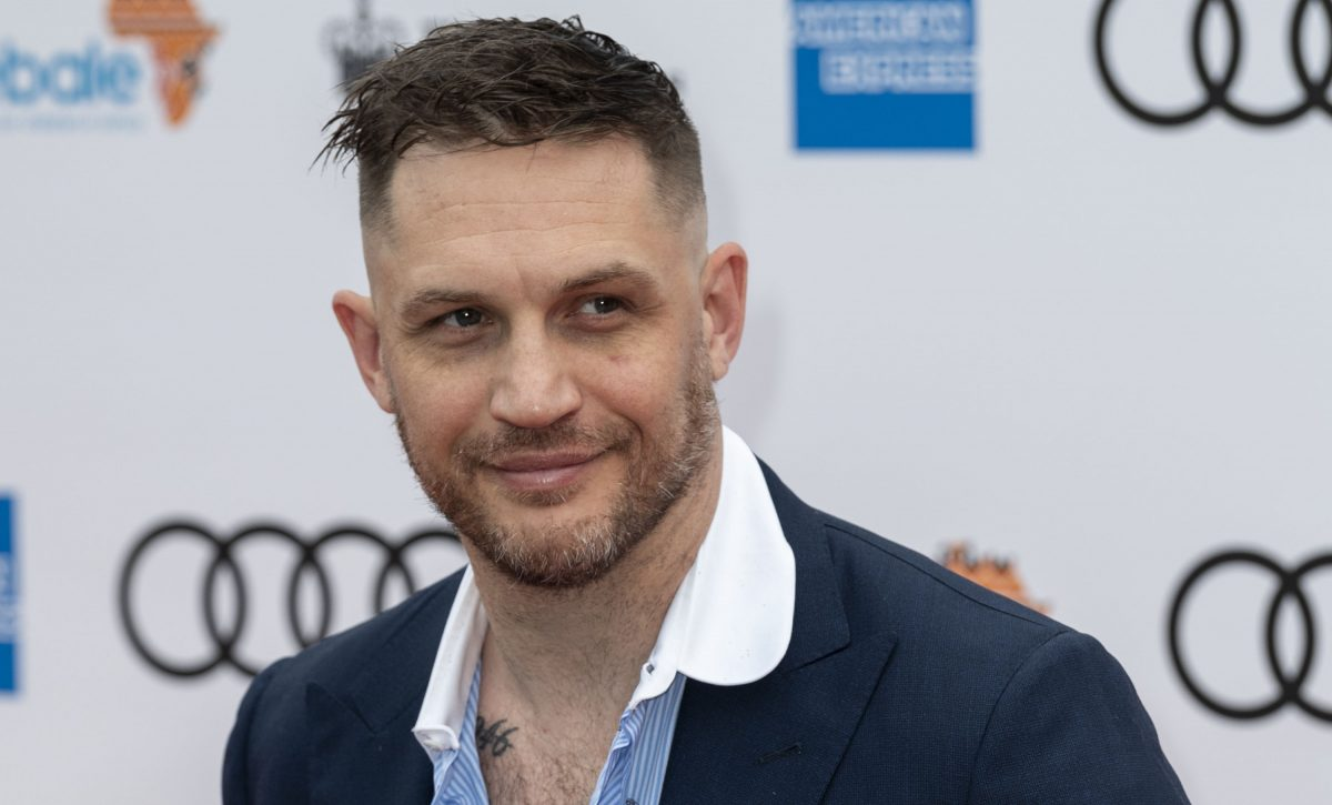 Tom Hardy smiles for a photo at the Sentebale Audi Concert at Hampton Court Palace