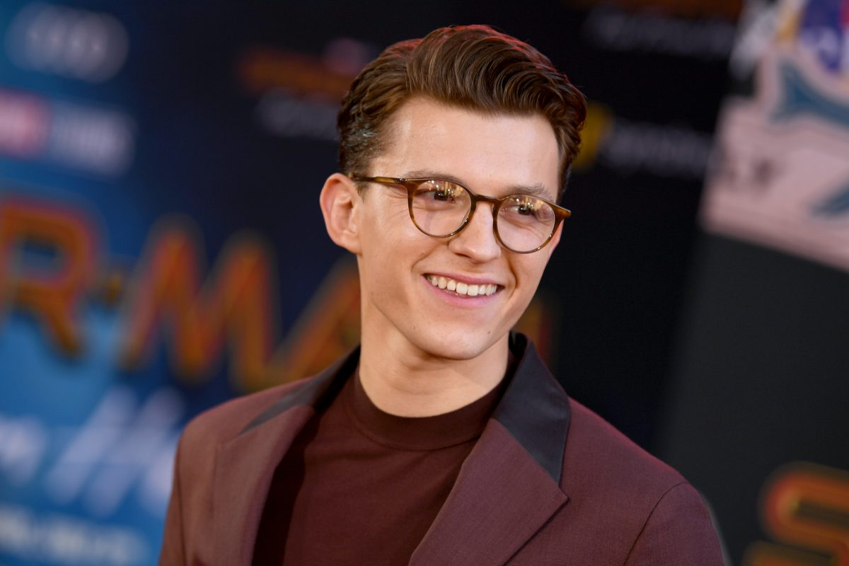 Tom Holland 'Spider-Man: No Way Home' wearing maroon suit and glasses