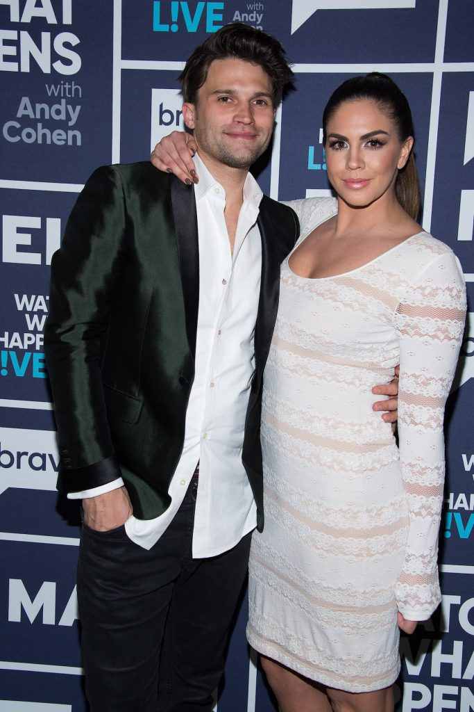 Tom Schwartz and Katie Maloney smile and pose for the camera at an event.