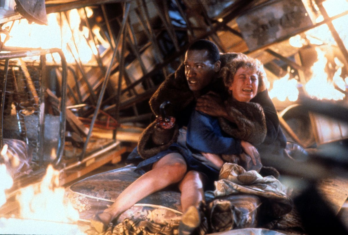 Tony Todd and Virginia Madsen sitting in 'Candyman' 1992 movie