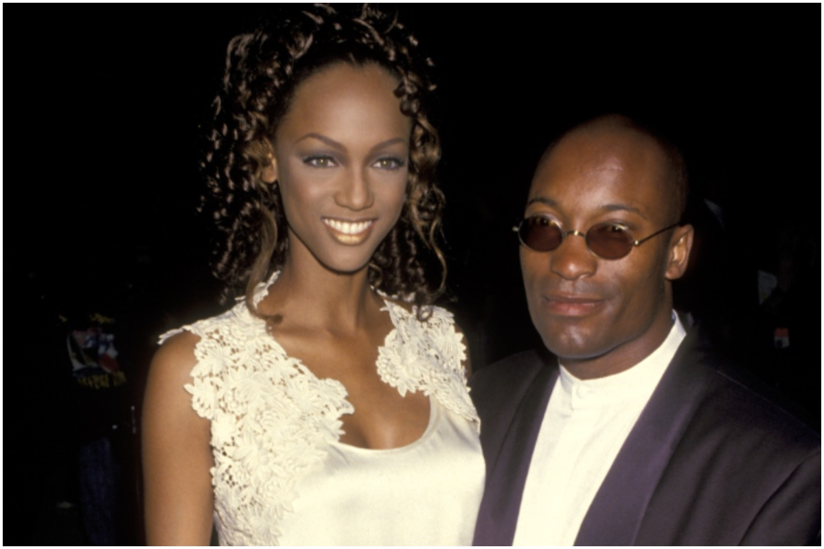 Tyra Banks and John Singleton embracing each other at a premiere in the 1990s.