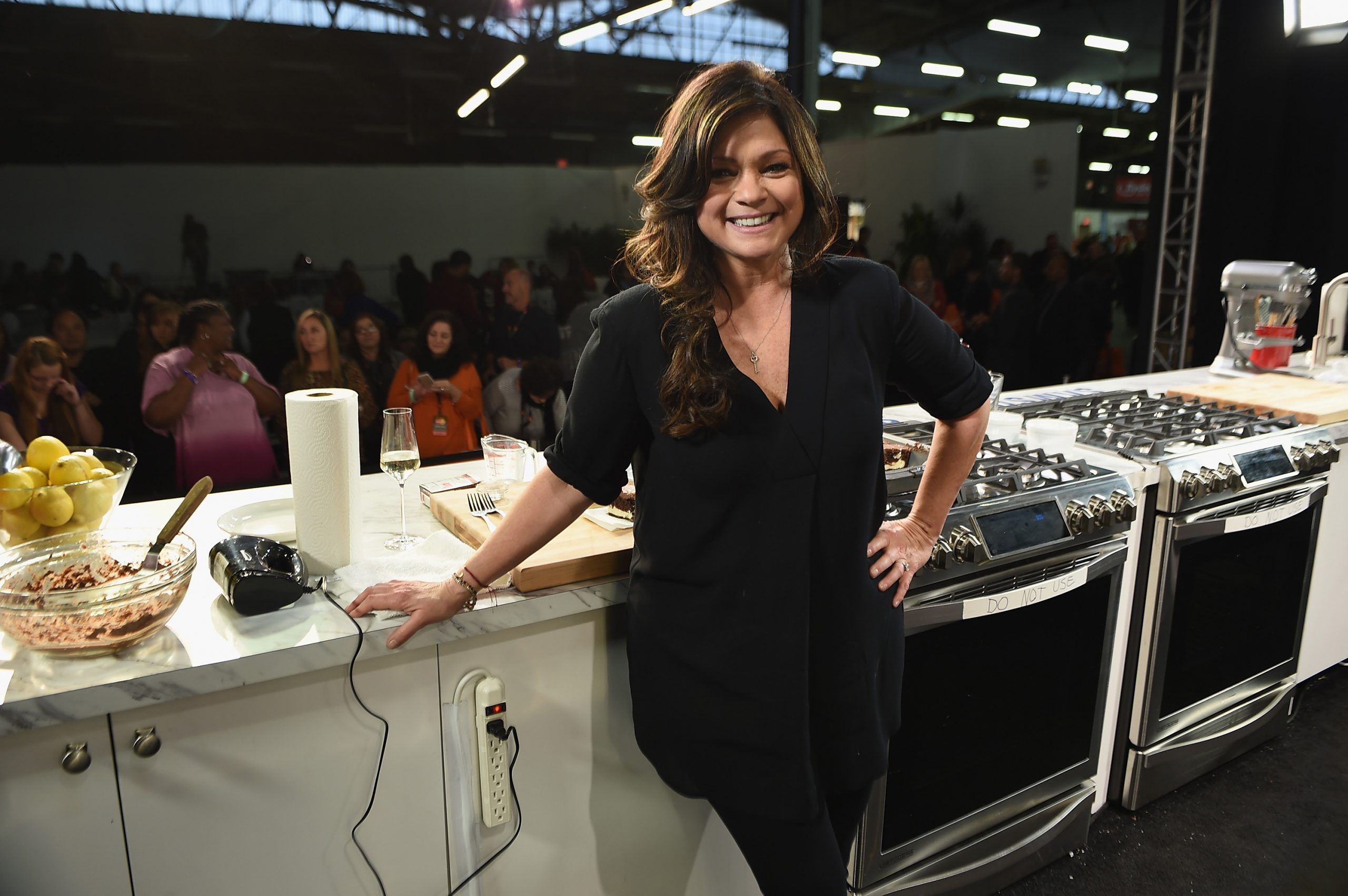 Food Network personality Valerie Bertinelli takes a break from meal prep to pose for a photo.