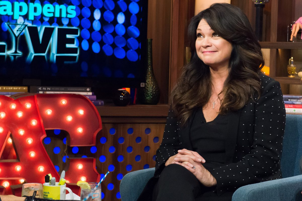 Food Network star Valerie Bertinelli smiles with her hands in her lap on 'Watch What Happens Live,' 2015