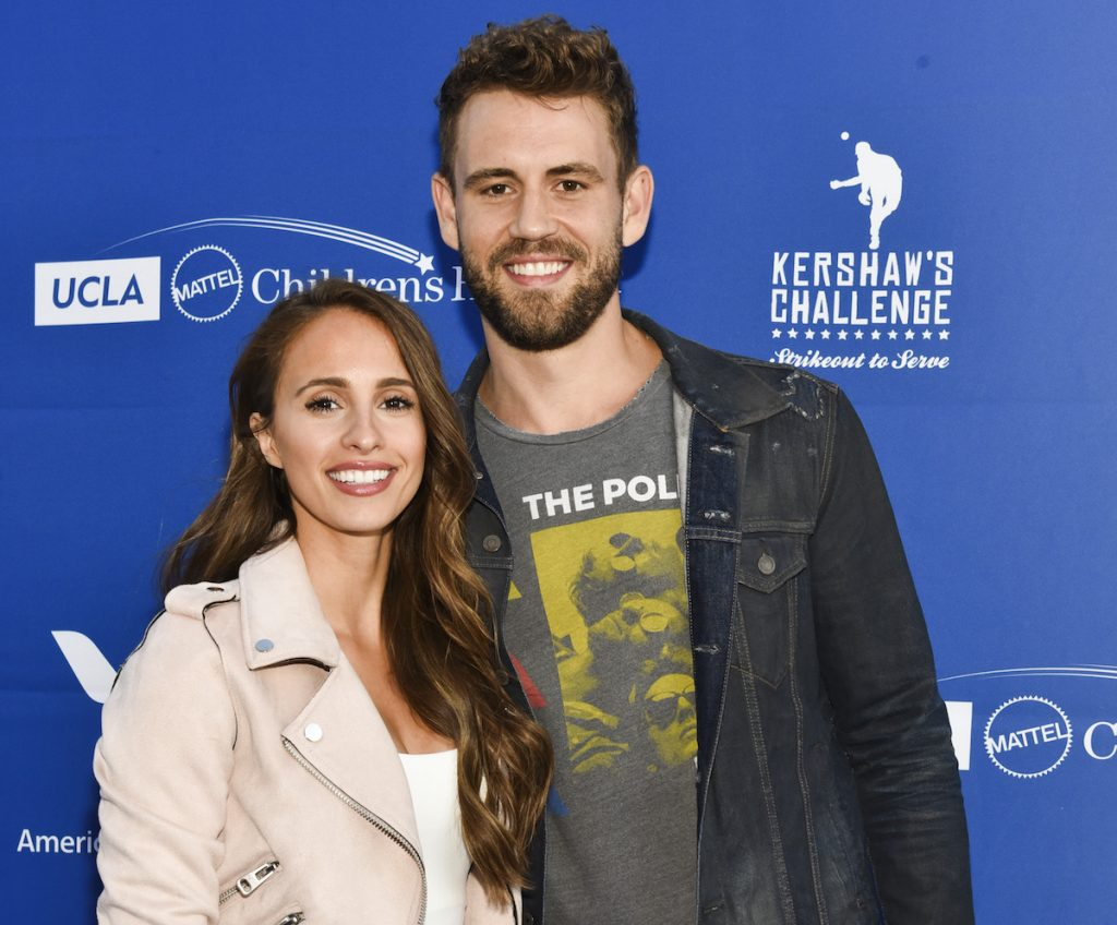 Vanessa Grimaldi and Nick Viall dressed casually at an event, facing the camera and smiling with their arms around each other.