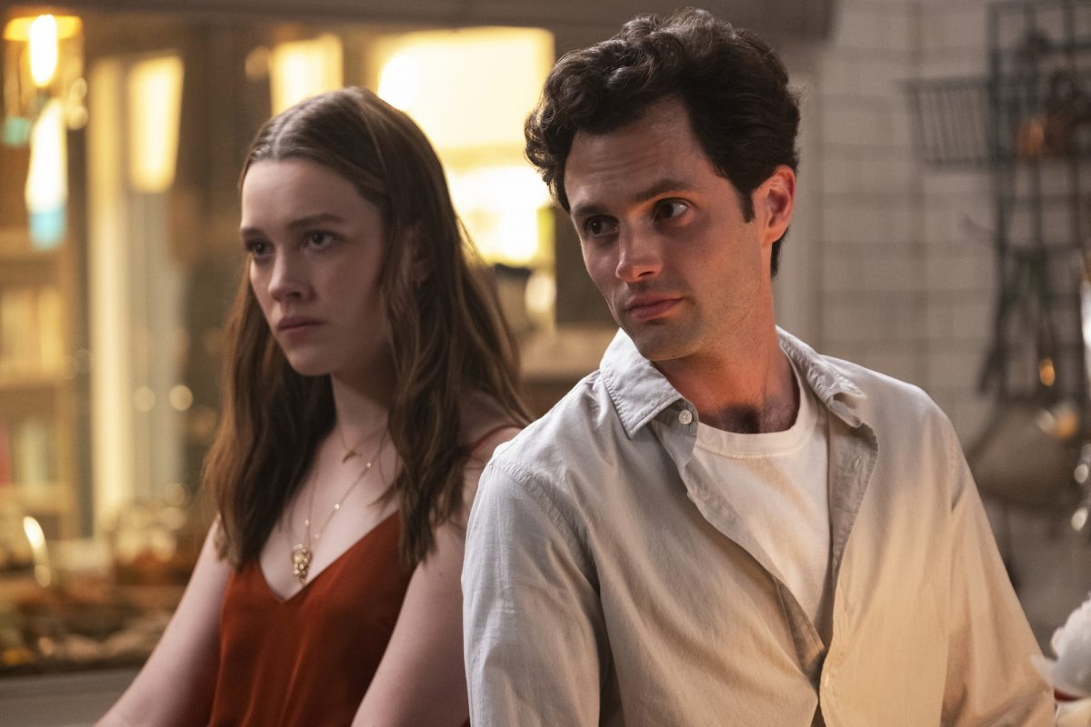 A production still of Victoria Pedretti and Penn Badgley as Love Quinn and Joe Goldberg in Netflix's 'YOU'