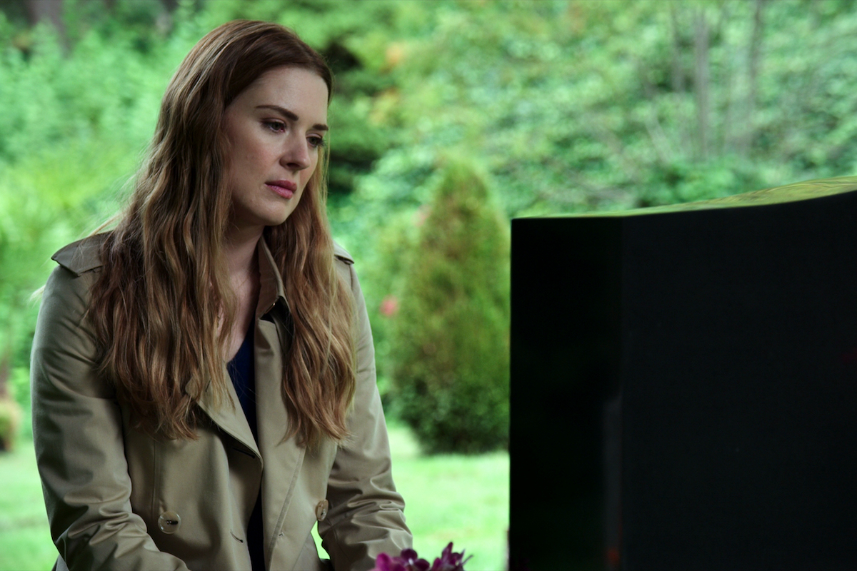Alexandra Breckenridge as Melinda Monroe sitting at a grave site in 'Virgin River'