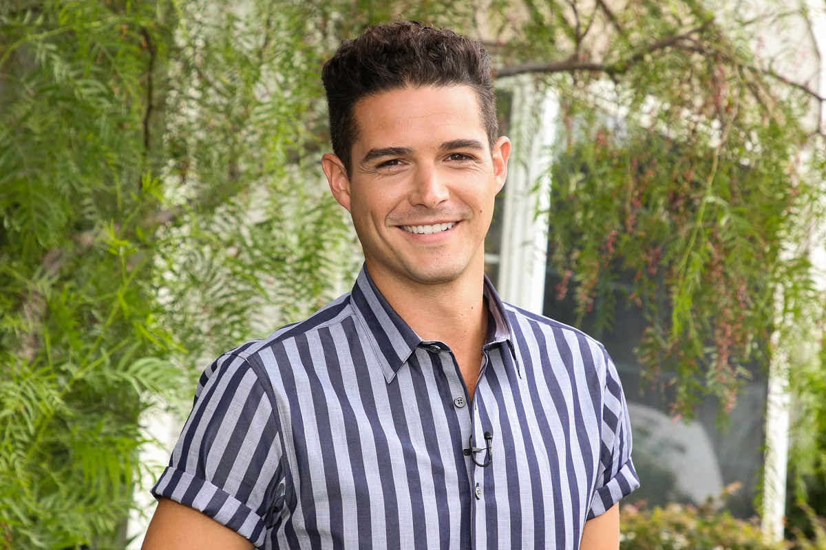 Wells Adams in a blue and white striped shirt.