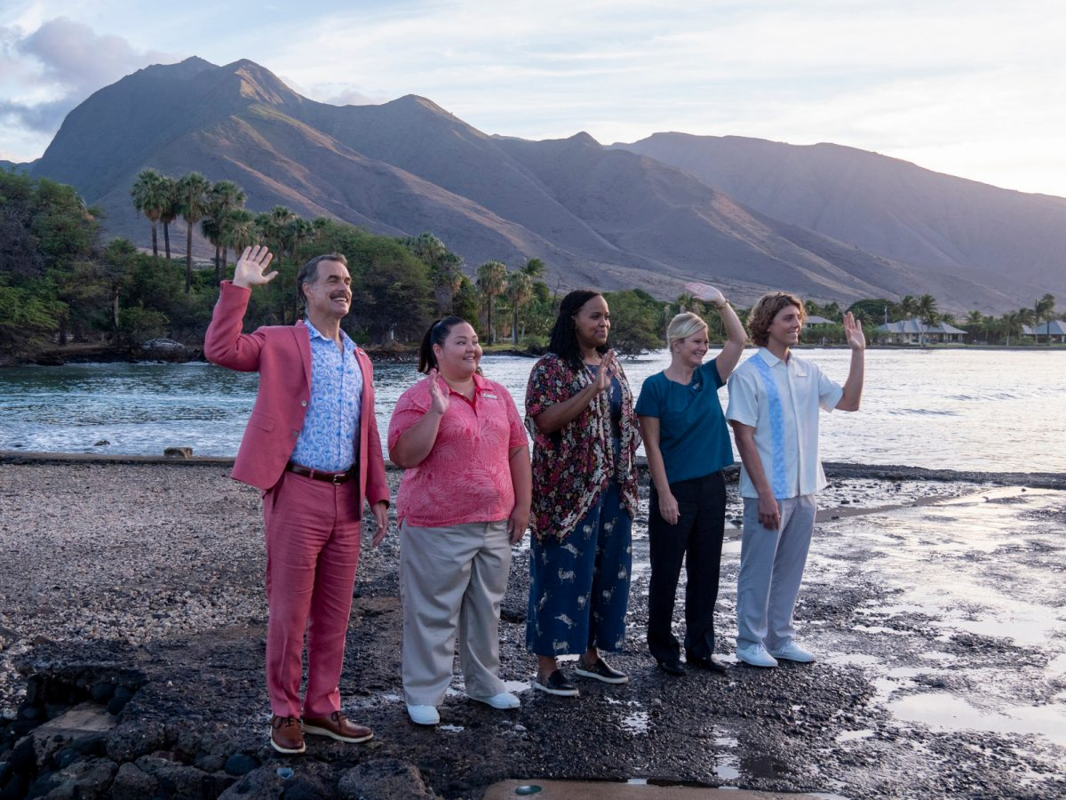 Murray Bartlett, Jolene Purdy, Natasha Rothwell, and Lukas Gage in 'The White Lotus' premiere, which is paralleled in the finale. They're standing on the beach and waving.