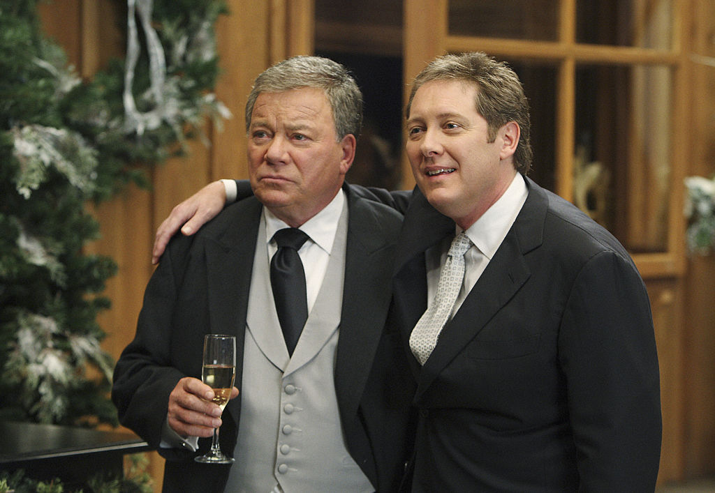 William Shatner and James Spader are dressed in suits. Spader has his arm around Shatner in this screen grab from 'The Practice'.