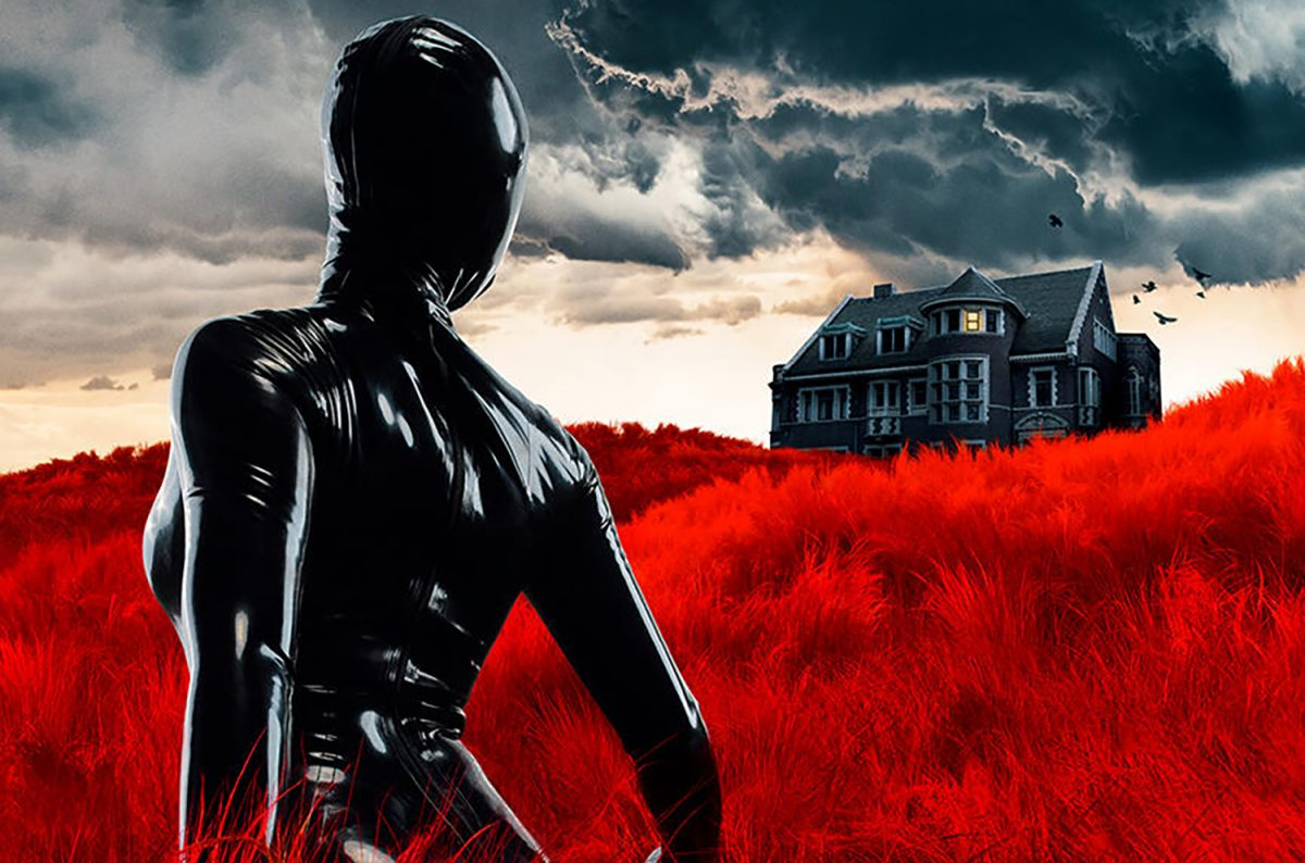 American Horror Stories Season 1 key art: a person in a black skin suit standing in red grass looking at a house in the distance