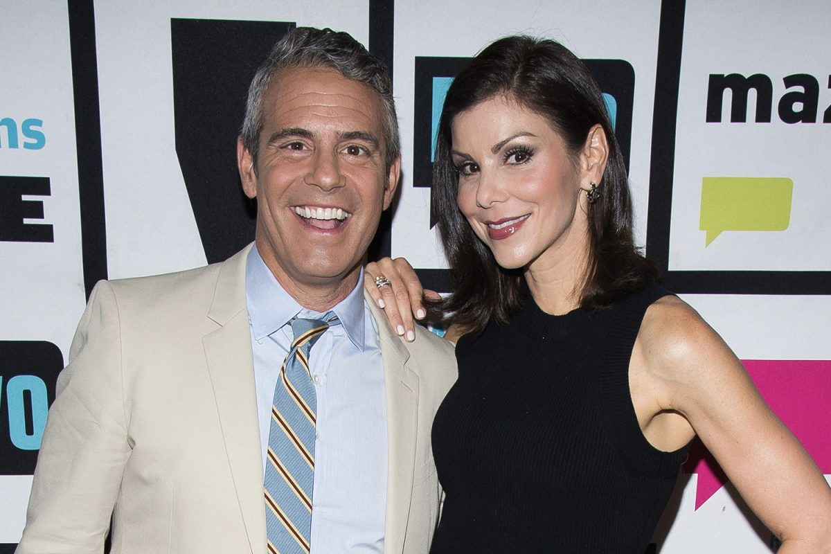 Andy Cohen and Heather Dubrow posing and smiling