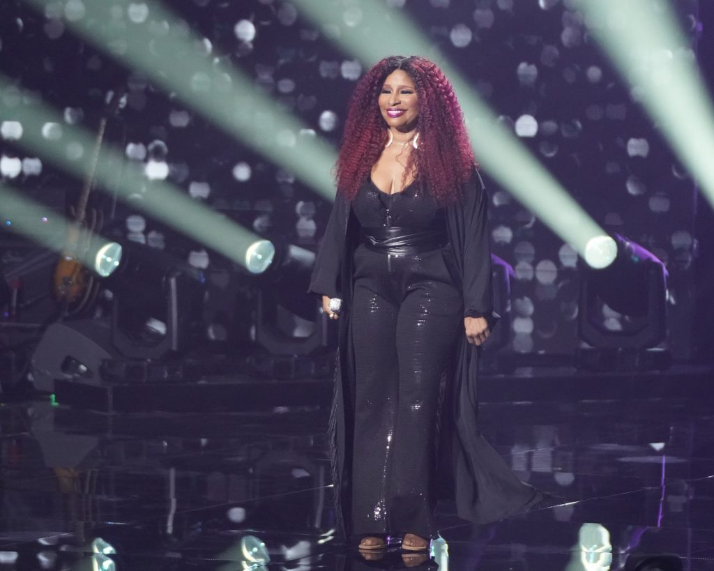 Chaka Kahn dressed in all black during a performance